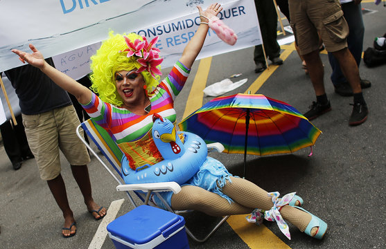 Drag queen Tchaka wears a float while sitting on a beach chair during a protest against Sao Paulo's State Governor Geraldo Alckmin and the severe water shortages, in Sao Paulo