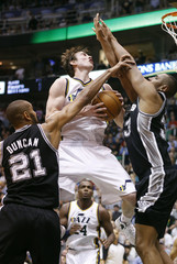 Utah Jazz guard Gordon Hayward attempts a shot while defended by San Antonio Spurs forward Tim Duncan and center Boris Diaw during the second half of their NBA basketball game in Salt Lake City, Utah