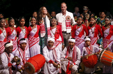 Britain's Prince William and his wife Catherine, the Duchess of Cambridge, pose for a photograph with dancers, who performed traditional Bihu dance, at a tourist lodge in Kaziranga