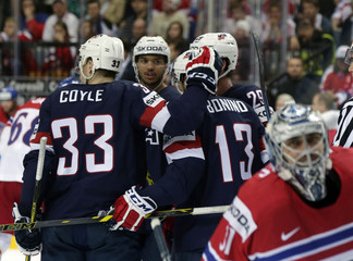 Bonino of the U.S. celebrates his goal against  the Czech Republic with team mates during their Ice Hockey World Championship third-place game at the O2 arena in Prague