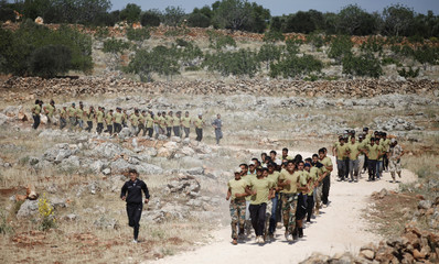 New Free Syrian Army recruits run in groups as they receive military training to join Jabhet Thowar Syria in Idlib