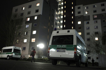 Picture shows police cars in front of a hall of residence in Bochum in which German police arrested an al Qaeda suspect today