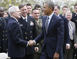 Obama shakes hands with Mabus after presenting Commander-in-Chief Trophy to U.S. Naval Academy football team in Washington