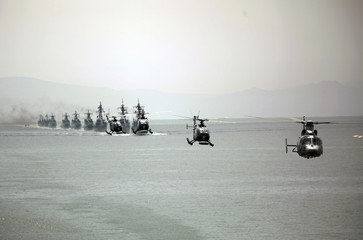 Mexican Navy combat ships and helicopters take part in military parade during ceremony on Navy Day at the port of Guaymas, Sonora