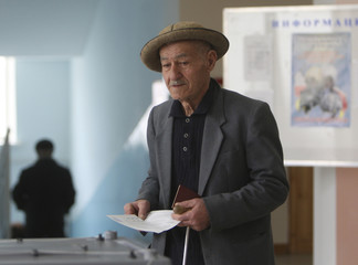 A man casts his vote at a polling station in Tskhinvali, in the breakaway region of South Ossetia