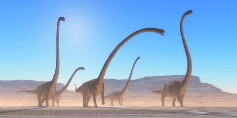 Omeisaurus Dinosaur Desert - An Omeisaurus herd walks across a dry desert in their search for vegetation and water in the Jurassic Period.
