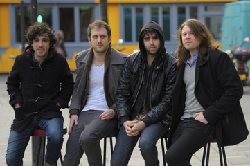 "Members of the band ""Stuck In The Sound"" pose for a photo after an interview with Reuters in Paris"
