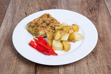 Vegetarian food on a plate with wooden background
