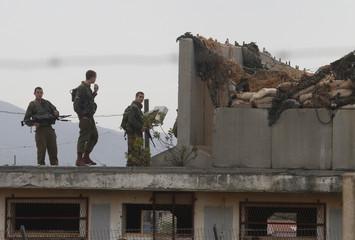 Israeli soldiers patrol the Lebanese-Israeli border as seen from the southern Lebanese village of Kfar Kila