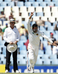 Captain  of Sri Lanka, Dilshan, appeals unsuccessfully as umpire Rod Tucker looks on during the second day of their first test cricket match against South Africa in Centurion