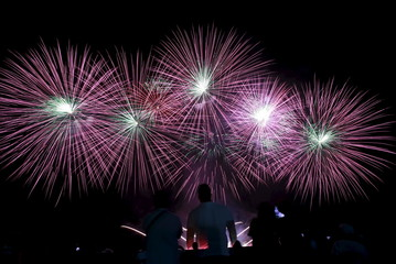 Spectators watch a fireworks display of defending champion Netherlands, as it lights up the sky during the 7th Philippine International Pyromusical Competition in Pasay city, metro Manila
