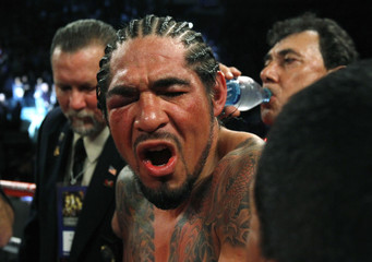 Margarito of Mexico reacts after his fight against Cotto of Puerto Rico was stopped due to an injury, in their WBA World Junior Middleweight championship boxing match in New York