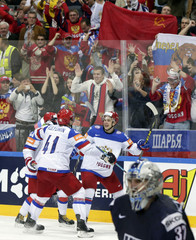 Russia's Shipachyov celebrates with team mates after scoring a goal against the US during their Ice Hockey World Championship semifinal game in Prague