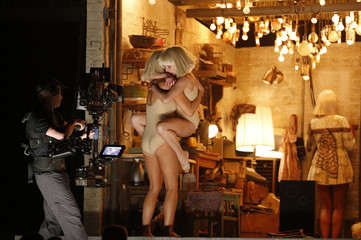 """Wiig and Ziegler dance to Sia's """"Chandelier"""" at the 57th annual Grammy Awards in Los Angeles"""