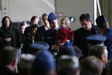 Family members of the aircrew who died in a helicopter accident, arrive for a memorial service at RAF Lakenheath in eastern England