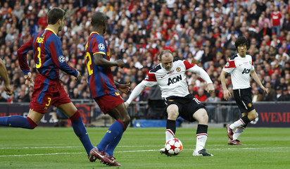 Manchester United's Rooney scores a goal against Barcelona during their Champions League final soccer match at Wembley Stadium in London
