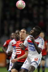 Erding of Stade Rennes challenges Olympique Lyon's Umtiti during their French Ligue 1 soccer match at the Route de Lorient stadium in Rennes