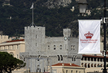 A flag announcing the wedding of Prince Albert II of Monaco and his fiancee Charlene Wittstock is seen with Monaco palace in the background