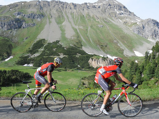 RadioShack's team riders Armstrong and Kloeden cycle on the Albula pass access road during the sixth stage of the Tour de Suisse from Meiringen to La Punt