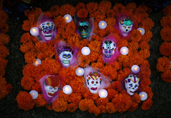Miniature skulls are seen decorated on an altar during the 14th annual Dia de los Muertos festival at Hollywood Forever Cemetery in Los Angeles