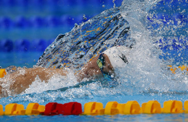 China's Sun Yang swims to win the men's 1500m freestyle final during the World Swimming Championships in Barcelona