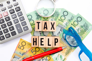 Tax Help - Australia - wooden letters with eyeglasses, money, magnifying glass and calculator