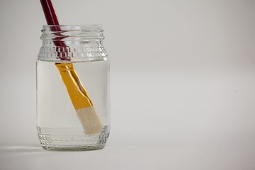 Paint brush in a jar filled with water