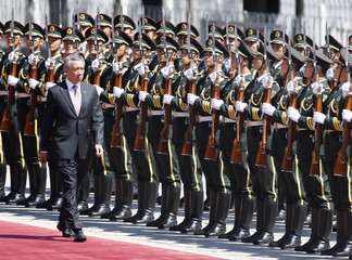 Singapore's Prime Minister Lee Hsien Loong inspects honour guards during a welcome ceremony outside the Great Hall of the People in Beijing