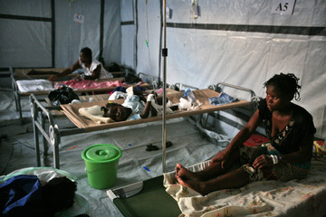 Haiti residents infected with cholera receive treatment in a clinic set up by the International Red Cross in Port-au-Prince