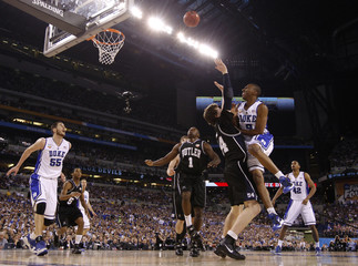 Duke's Smith shoots over Butler's Howard in their NCAA national championship college basketball game in Indianapolis