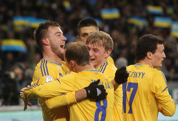 Ukraine's Andriy Yarmolenko celebrates his goal with team mates during their 2014 World Cup qualifying first leg playoff soccer match against France at the Olympic stadium in Kiev