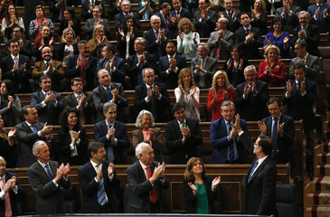 Spain's Prime Minister Mariano Rajoy waves to Popular Party deputies after his state-of-the-nation address at parliament in Madrid