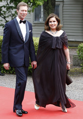 Grand Duchess Maria Teresa of Luxembourg and Grand Duke Henri of Luxembourg arrive for a Government dinner at the Eric Ericson Hall in Skeppsholmen