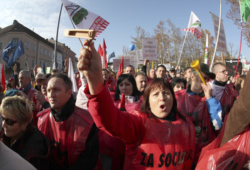 Protesters shout slogans during a protest against the government's austerity policies in Ljubljana
