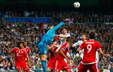 Bayern Munich's goalkeeper Neuer saves a high ball during their Champions League semi-final first leg soccer match against Real Madrid at Santiago Bernabeu stadium in Madrid