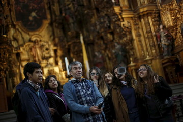 Tourists take a selfie inside the Metropolitan Cathedral in Mexico City