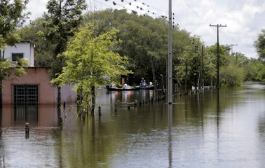 Houses partially submerged in floodwater are seen in the flood-affected Alberdi city
