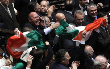 Members of the People of Freedom party celebrate in the parliament in Rome