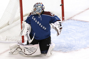 Avalanche goalie Varlamov looks the wrong way as a shot goes in for a first period goal during NHL hockey game in Denver