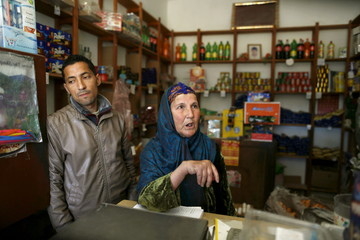 Abaidine looks on from his mother's shop in impoverished Zhor neighborhood of Kasserine