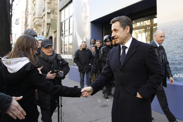 France's President and candidate for the 2012 French presidential elections Nicolas Sarkozy leaves his campaign headquarters in Paris