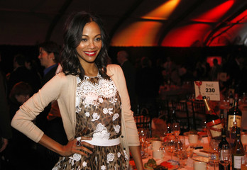 Actress Zoe Saldana poses for pictures at the cocktail party before the 2011 Film Independent Spirit Awards in Santa Monica, California.