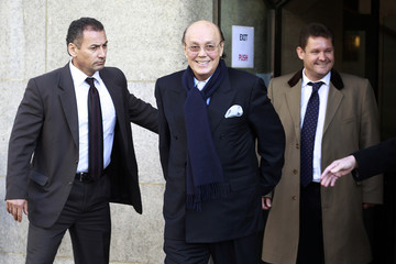 Turkish Cypriot businessman Asil Nadir (R) leaves the Old Bailey courthouse after pleading not guilty to 13 charges in London