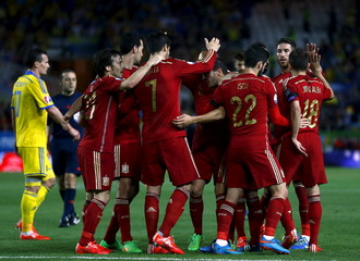 Spain's Morata is congratulated by teammates after scoring against Ukraine during their Euro 2016 qualifier in Seville