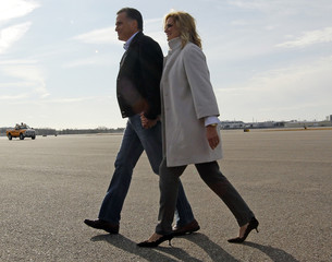 Republican presidential candidate and former Massachusetts Governor Romney and wife Ann walk across tarmac after arriving in Manchester