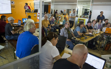 People watch presentation on how to encrypt emails at workshop on protection of online privacy organised by Pirate Party in Berlin