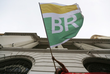 Woman waves a flag with Petrobras' logo as she takes part in a demonstration in defense of Brazil's President Dilma Rousseff and the state-run oil company Petrobras, in Rio de Janeiro