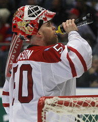 Goaltender Chris Mason of Canada drinks during the Ice Hockey World Championships quarter-final match against Russia in Cologne