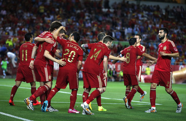 Spain's Torres is congratulated by teammates after scoring against Bolivia during their international friendly soccer match in Seville