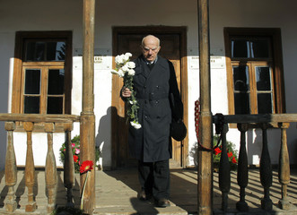 A man holds flowers as he attends a rally marking the birthday anniversary of Soviet dictator Josef Stalin outside the house where he was born in the town of Gori